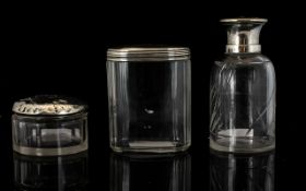 Two Silver Topped Glass Vanity Jars To include pin jar and powder jar - all hallmarks rubbed.