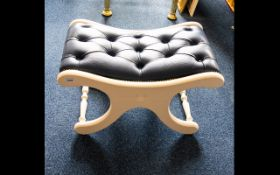 X - Framed Concave Footstool - royal blue leather button rest on white painted frame. 15 inches