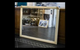 A Large Over Mantle Mirror Rectangular form bevelled glass mirror in reeded art deco style frame