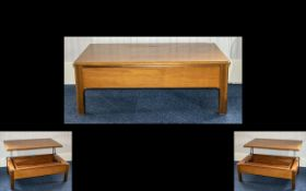Parker Knoll 1970's Coffee Table With Integral Storage Teak hinged cantilevered top with central