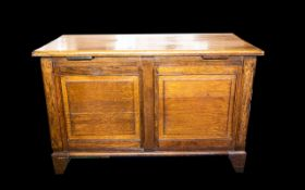 Golden Oak Coffer - early 20th century panelled bedding box comprising hinged lid,