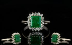18ct White Gold Attractive Emerald And Diamond Cluster Ring Fully hallmarked,