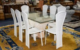 A Modern Continental Table And Chairs Bevelled glass table with brick and marble effect V-Form