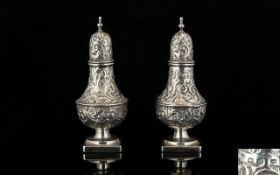 Victorian Period - Persian Style Pair of Ornate Solid Silver Pepperettes with Extensive Embossed