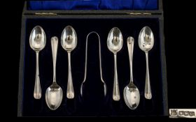 A Boxed Set of 6 Silver Hall Marked spoons with matching tongs. Sheffield 1919. Makers C B and S.