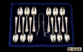 Mappin and Webb Boxed Set of 12 Silver Teaspoons + Matching Pair of Sugar Nips.