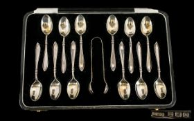 1920's Boxed Set of 12 Sterling Silver Teaspoons + Matching Sugar Nips.