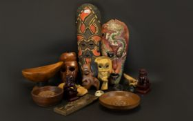 A Mixed Collection Of Carved Decorative Masks And Collectibles All modern tourist pieces,