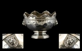 A Silver Footed Bowl Raised on stepped circular base with heraldic style meandering edge and lion
