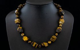 Tiger Eye Fancy Cut Bead Necklace, a strand of smoothly faceted cuboid tiger eye beads,