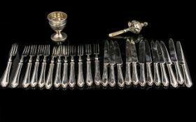 A Set of 12 Forks and Dessert Knives (24) pieces.