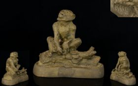A Bronze Sculpture Of A Monkey On A Log