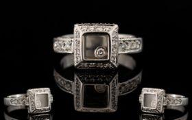 An 18ct White Gold And Diamond Set Chopa