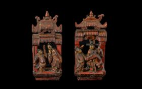 Two Oriental Red Lacquered Mounts in the form of temples, with figures. Height 7 inches.
