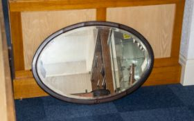 Antique Mahogany Framed Bevelled Glass Mirror. Oval over mantle mirror, of plain rustic form with