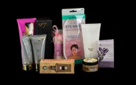 Box of Cosmetics including Body Shop Vanilla Chai body scrub;