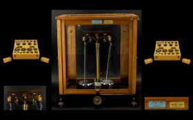 Early 20th Century Towers Model 55 Scientific Laboratory Scales Oak case with glazed sides,