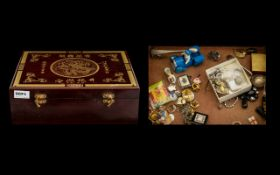A Chinese Style Box containing various collectables.