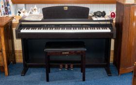 Yamaha Electric Piano Clavinova CLP-130 with matching footstool.