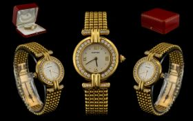 Cartier - Rivoli 18ct Gold and Diamond Set Ladies Wrist Watch. Date 1997.