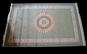 A Large Woven Silk Carpet Abusson rug with green ground and with traditional floral and foliate