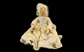 A Vintage Wax Doll Handmade doll with wired armature, cloth body, wax feet, hands and head.