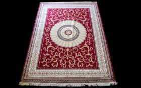 A Large Woven Silk Carpet Abusson rug with red ground and with traditional floral and foliate