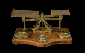 A 1920's Oak And Lacquered Brass Pan Scales marked 'Warranted accurate' mounted on shaped oak base,