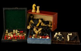 A Collection Of Four Early 20th Century Travelling Chess Sets To include turned bone/cellulose
