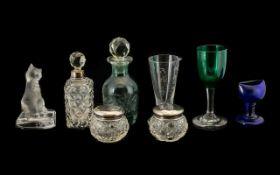 An Assorted Collection of Glasses and Small Silver Miniatures. .