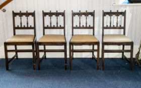A Set Of Four Jacobean Style Dining Chairs carved and spindle back with drop-in seat, square cross-
