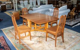 A 1970'S Drop Leaf Table And Four Chairs Of typical form, table when folded 36 x 12 inches, 28