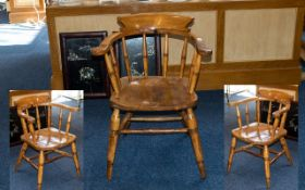 "Windsor Style Chair. Kitchen armchair, spindle back, raised on four legs. Height 28"" x 25""."