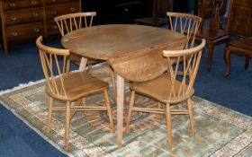 Ercol Table & Four Chairs. Chairs cross-banded style.