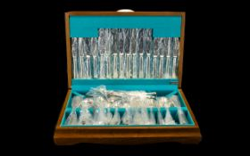 Boxed Set of Cutlery housed in an attractive wooden box.