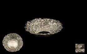 A Victorian Silver Embossed Dish floral embossed decoration, hallmarked for London U 1895.