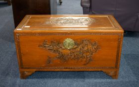 Camphor Chest, Oriental carved lid and sides depicting fighting warrior scenes.