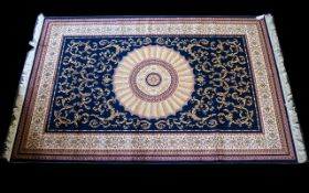 A Large Woven Silk Carpet Abusson rug with blue ground and with traditional floral and foliate