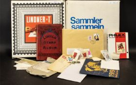 Two Albums Containing A Quantity Of Stamps Lindnet T - album complete with outer slip case,
