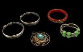 A Collection of Bracelets to include two continental silver bangles engraved with dragons,