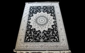 A Large Woven Silk Carpet Keshan rug with black ground and grey border with traditional floral and