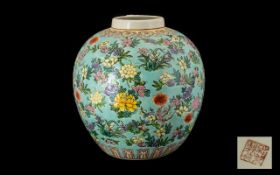 A Globular Shaped Oriental Vase powder blue ground with blossom throughout. height 11 inches.