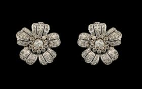 An Antique Pair of Stunning 18ct White Gold Diamond Set Earrings of Large Proportions In a Flower