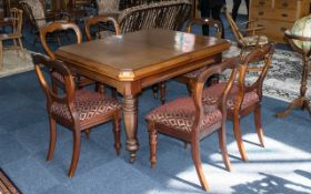 Victorian Extending Table in mahogany, with two wind-out leaves, and six balloon back chairs.