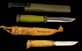 Two Hunting Knives. One handmade Swedish knife, and one Swedish Mora 2000.