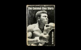 Boxing Interest. Hard back book titled 'The Cassius Clay Story by George Sullivan'.