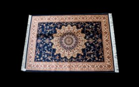 A Large Woven Silk Carpet Keshan Rug with blue ground and cream border with traditional floral and