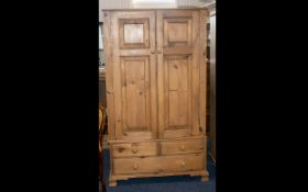 A Good Quality Solid Pine Compact Two Drawer Wardrobe with the two panelled doors opening to reveal