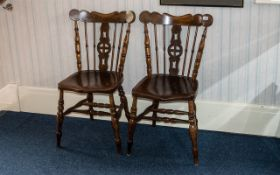 Two Antique Rustic Elm Kitchen Chairs in traditional spindle back design with central decorative