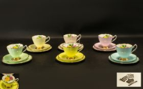 A Set of 6 Longton Cavourware China Trios comprising of 6 pastel shade sets with floral decoration